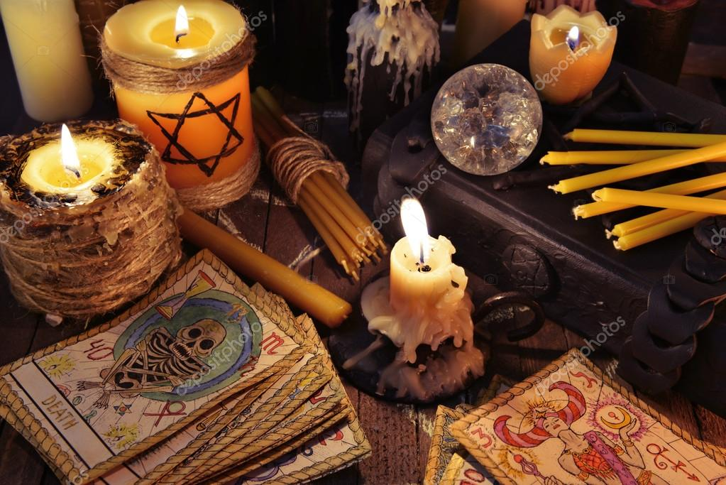 depositphotos_102955810-stock-photo-tarot-cards-candles-crystal